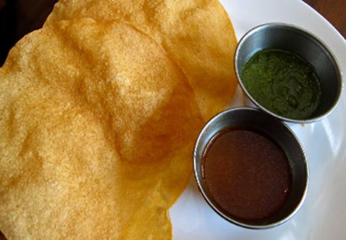 Free poppadoms and chutneys at Bollywood Spice CB25