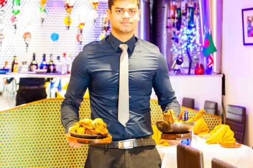 restaurant boy bengal village at E1